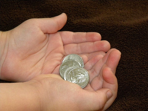 Money in Childs Hands by Hobbies on a Budget on flickr